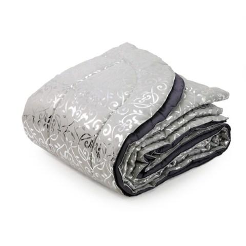 Trapunta alcantara grigio laminata in argento con texture floreale
