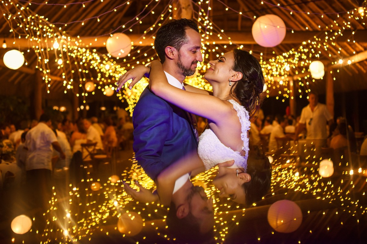 Bride and groom first dance shot with string lights at Blue Venado Beach Club, Mexico. Martina Campolo Riviera Maya Wedding Photography