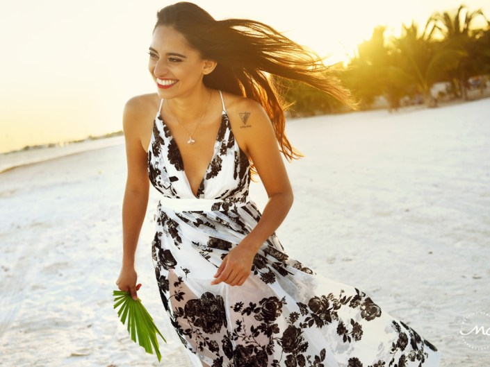 Smiling model in floral maxi dress at Maroma Beach, Mexico. Martina Campolo Photography