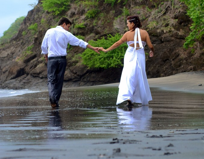 Bride and groom beach portraits in Playa Hermosa, Costa Rica. Martina Campolo Photography