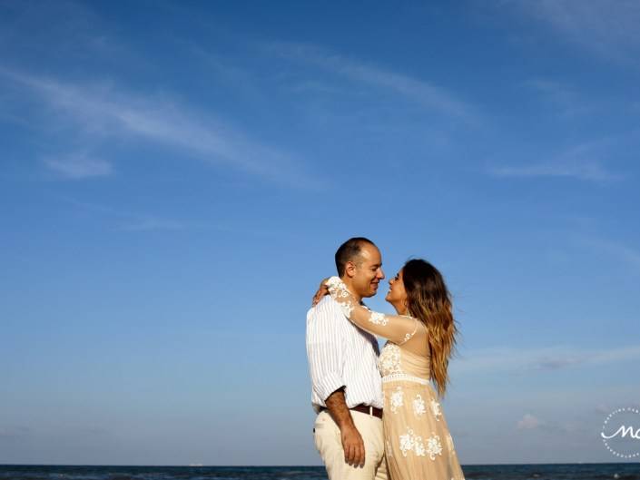 Couple embraces in a hug. Playacar engagement session by Martina Campolo Photography in Mexico