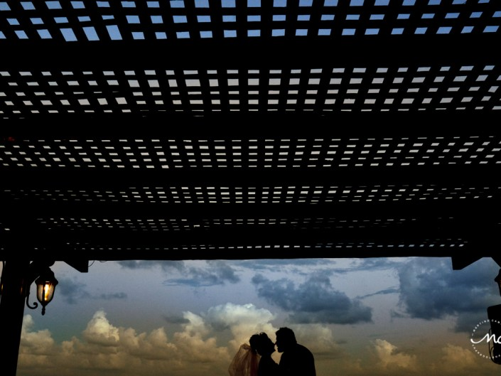 Bride and groom sunset sihouettes. Now Sapphire Riviera Cancun wedding by Martina Campolo Photography