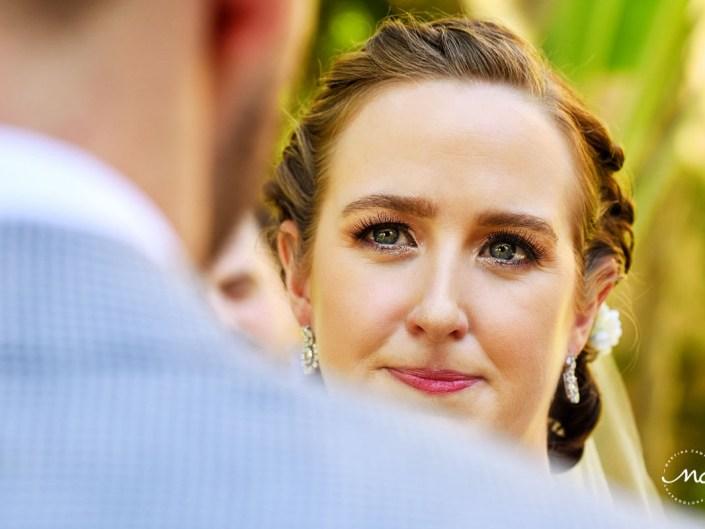 Closeup pic of bride at wedding ceremony in Hacienda del Mar, Puerto Aventuras, Mexico. Martina Campolo Photography