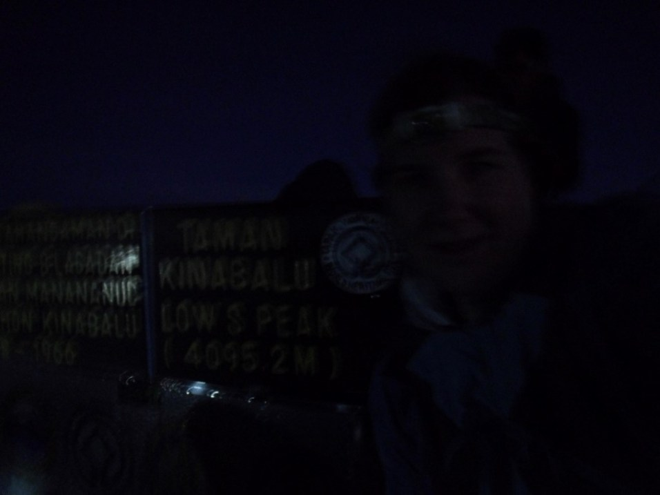 Proof. Me with the sign at the top of Mt Kinabalu.