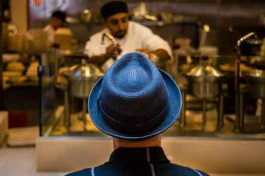 Man in Blue Hat by Ibarionex Perello