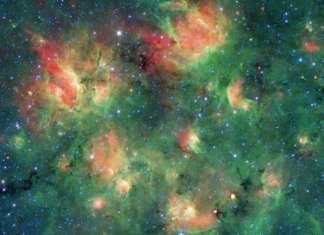 Esta nube de gas y polvo está llena de burbujas hinchadas por el viento y la radiación de jóvenes estrellas masivas. Crédito de la imagen: NASA/JPL-Caltech