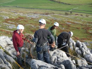 Setting up bottom rope climbs at the top of Twistleton Scar
