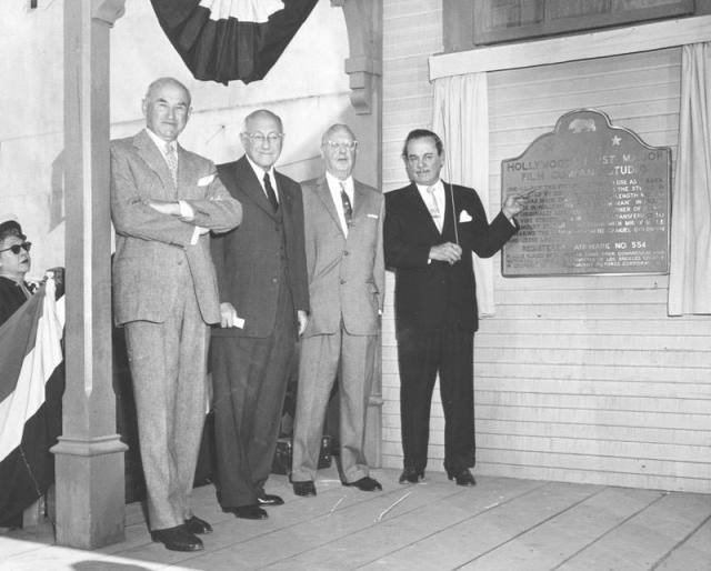 December 29, 1956, The Lasky-DeMille Barn becomes a California Historic Landmark. At the ceremony are, from left- Samuel Goldwyn, C.B. DeMille, Jesse Lasky and Leo Carrillo