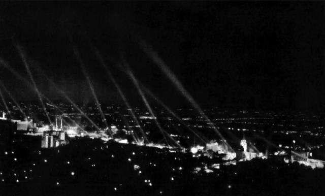 Searchlights punctuate the night sky above Hollywood Boulevard, circa 1932