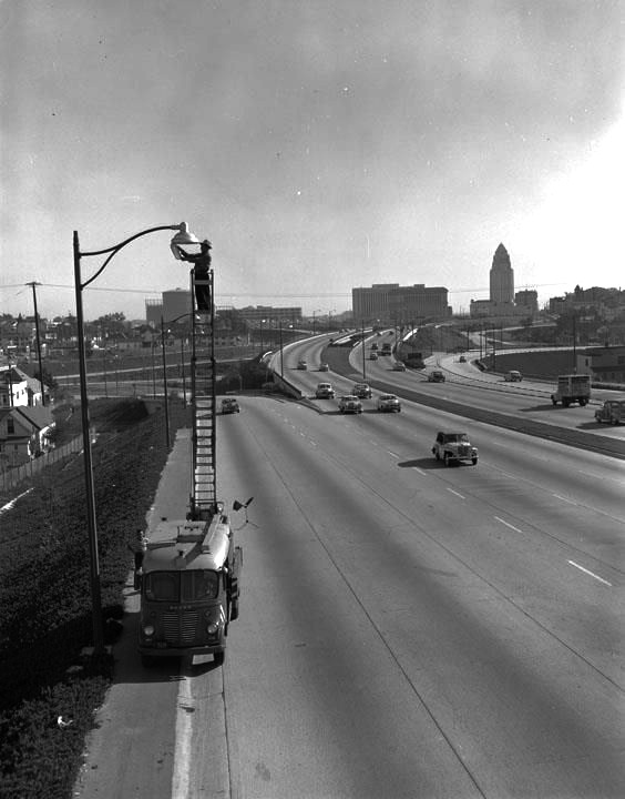 Guy changing the lights on the Hollywood Freeway 1952