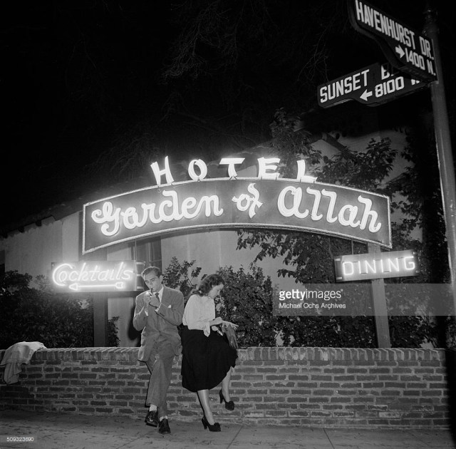Couple sits outside the Garden of Allah Hotel on Sunset Blvd