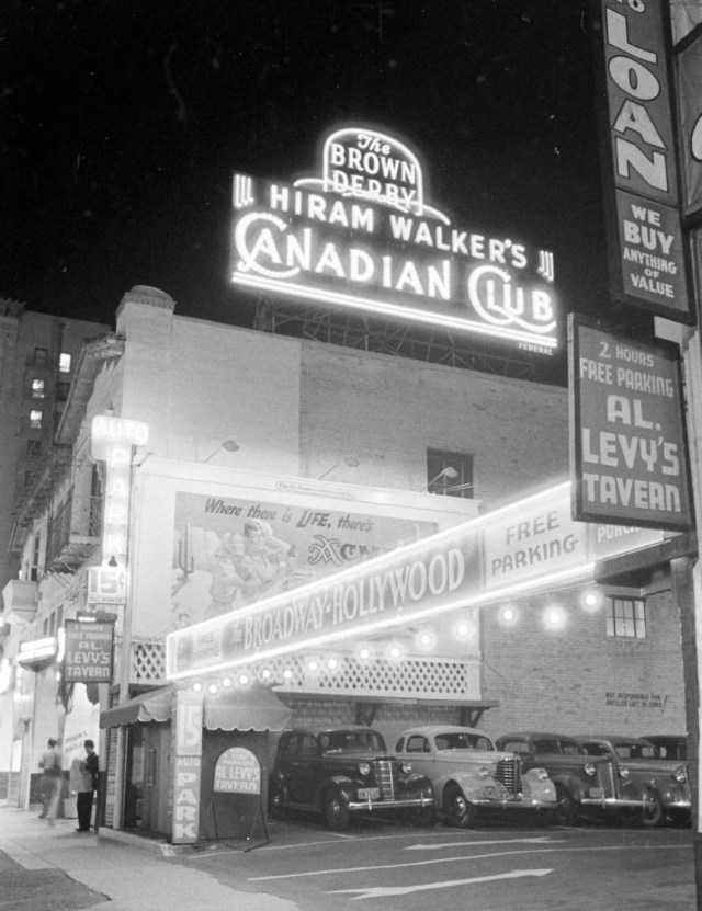Parking lot for the Brown Derby, Broadway department store, and Al Levy's Vine St, Hollywood, 1938