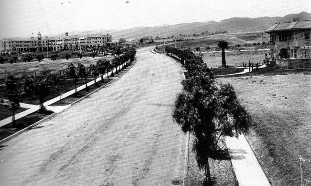 Looking northwest on N. Crescent Dr from Lomitas Ave, with Beverly Hills Hotel in the background, 1915