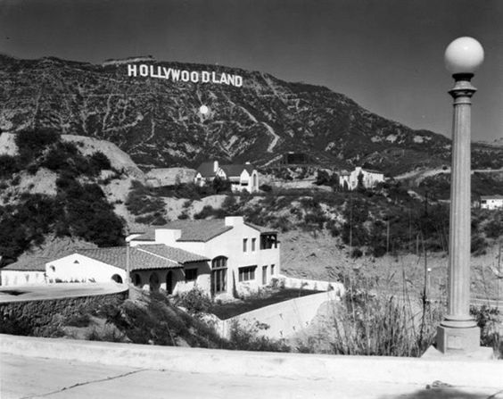 HOLLYWOODLAND sign and nearby homes seen in the foothills, 1926
