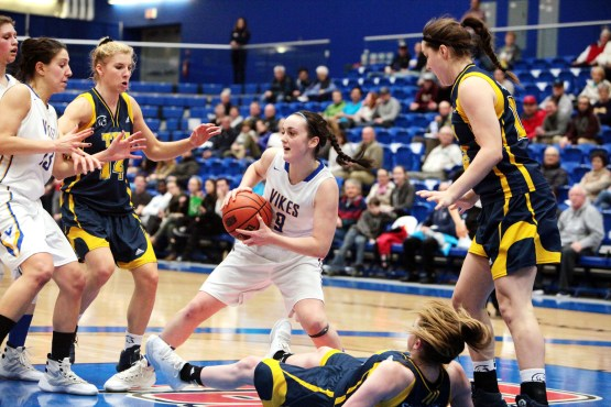 Kristy Gallagher squares off against the Trinity Western University Spartans. Photo by Neil Hodge.