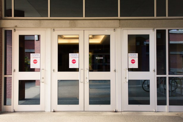 David Strong Building with COVID-19 notices on the doors
