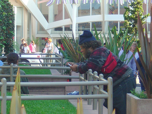 homeless guy on a cell phone