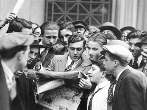 People reading a newspaper