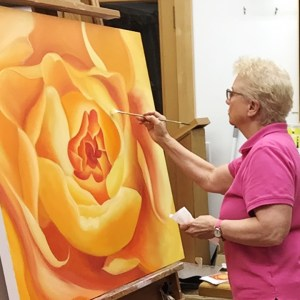 Mary Ahern Painting in the Studio