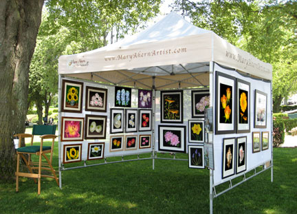 Mary Ahern Artist booth in The Northport Art in the Park annual event