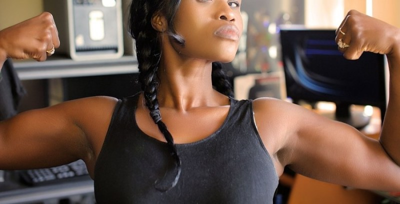 black girl flexing her muscles