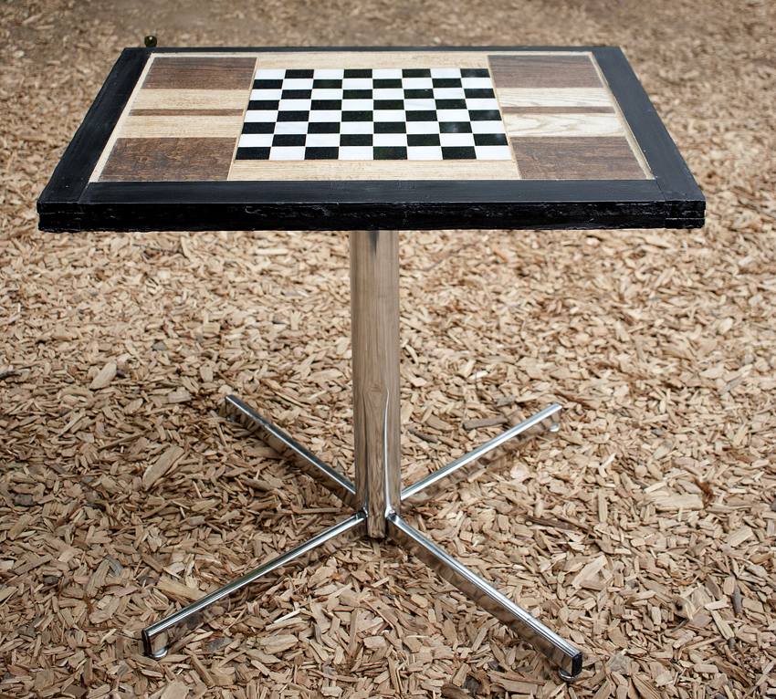 Completed handcrafted tile table with checkerboard design. Design by Mark Funk. Photo by Mary Anne Funk