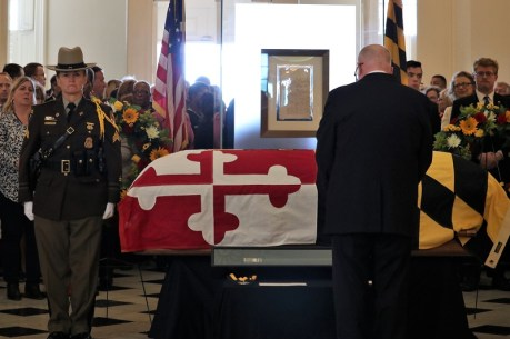 Gov. Lawrence J. Hogan Jr. (R) pauses at the coffin of the late Speaker Michael E. Busch. Photo by Danielle E. Gaines