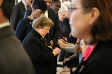 While talking with the late Speaker Michael E. Busch's family, former U.S. Sen. Barbara Mikulski holds up the Speaker's Medallion that Busch presented to her. Photo by Danielle E. Gaines