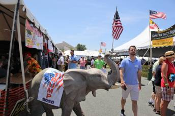 Maryland Democratic Party Secretary Robbie Leonard passes by a Republican tent at the 43rd annual J. Millard Tawes Crab and Clam Bake.