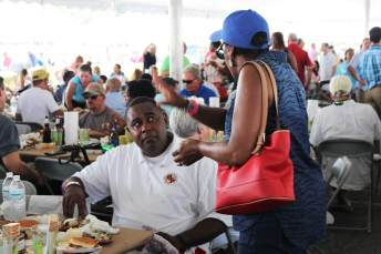 Del. Darryl Barnes (D-Prince George's) talks with Sandy Pruitt of the People for Change Coalition at the Tawes Crab Feast on Wednesday.