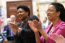Delegates Melissa Wells and Robbyn Lewis (both D-Baltimore City) cheer near the end of the 2020 legislative session. Photo by Danielle E. Gaines.