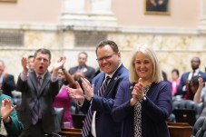 House Majority Leader Eric G. Luedtke (D-Montgomery), House Minority Leader Nicholaus R. Kipke (R-Anne Arundel) and House Minority Whip Kathy Szeliga (R-Baltimore County) cheer near the end of the 441st General Assembly session. Photo by Danielle E. Gaines.