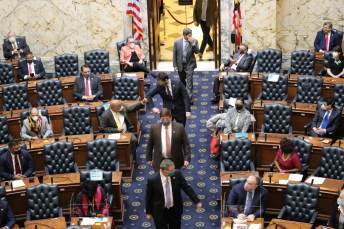 Members of the House of Delegates file in for the opening day of the 2021 legislative session. Photo by Danielle E. Gaines.