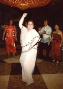 Surrounded by friends and family, Pilar Palacios Pe dances at a party in 2006. Family photo.