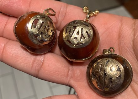Deer's eye pendants or ojo de venado, belong to Janier Escano, Danitza Simson (deceased), and Adonis Escano. Simpson's two grown sons say the necklaces connect them to their mother after she died of COVID-19 in October. Janier now wears his mother's pendant on a chain with his. Photo courtesy of Karla Simpson.