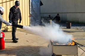 A trainee puts out a fire during a session at Arcon Training Center, which is preparing workers for Maryland's nascent offshore wind industry. Photo courtesy of Arcon Training Center.