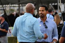 Democratic gubernatorial candidate Wes Moore chats with Montgomery County Councilmember Will Jawando (D) at the 2021 J. Millard Tawes Clam Bake and Crab Feast. Photo by Danielle E. Gaines.