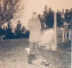 Jack with turkey under surveillance, 1958