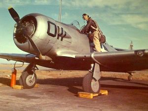 Jack Lawlor climbing into a T-6 Texan Trainer, c. 1943
