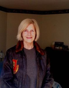 """In my Dad's flight jacket from the Korean War--my bio photo for """"Songs of Ourselves"""" an anthology of writing inspired by Walt Whitman, coming out soon with Blue Heron Book Works. I edited the volume and wrote the introduction."""