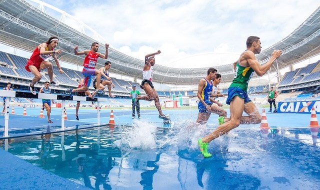 action athletes competition hurdle men people race running splash sport stadium track and field water running running running running running
