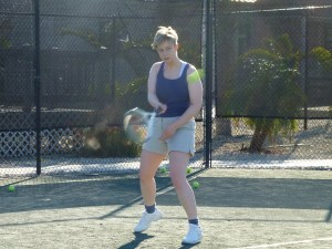 Sarah on the tennis court really keeping her eye on the ball