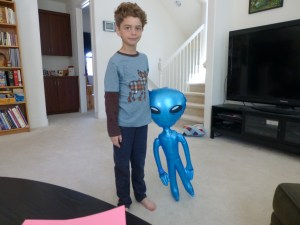 Nathan looking pretty tall with his alien bought with skeeball tickets