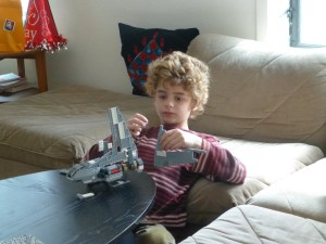 Nathan builds his Lego craft intently
