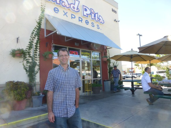 Jon outside one of our favorite lunch spots, Mad Pita Express.