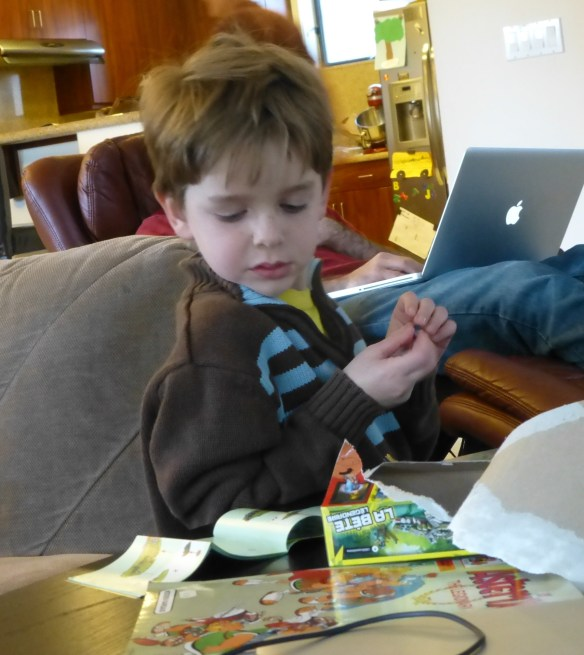 Sam works intently on his Lego creation