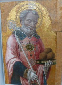 St. Nicholas holding his three bags of gold that he gave to three young women so they could have dowries instead of becoming prostitutes