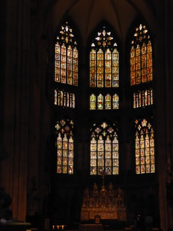 Stained glass windows behind the altar
