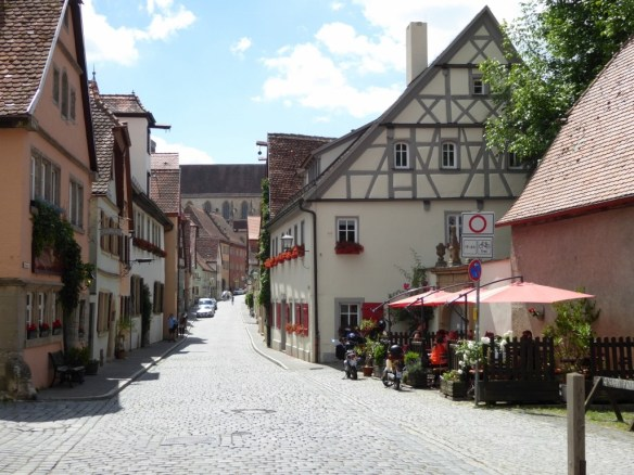 Typical pretty street in Rothenburg. St. Jacob church in the background