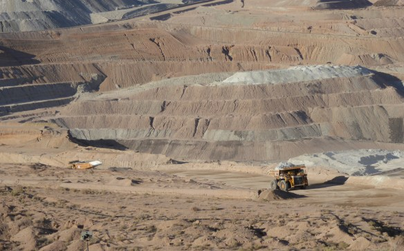 Trucks entering and leaving the pit with ore